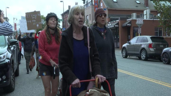Homeless advocates walk down Congress St. in a march for World Homeless Day. (WGME)
