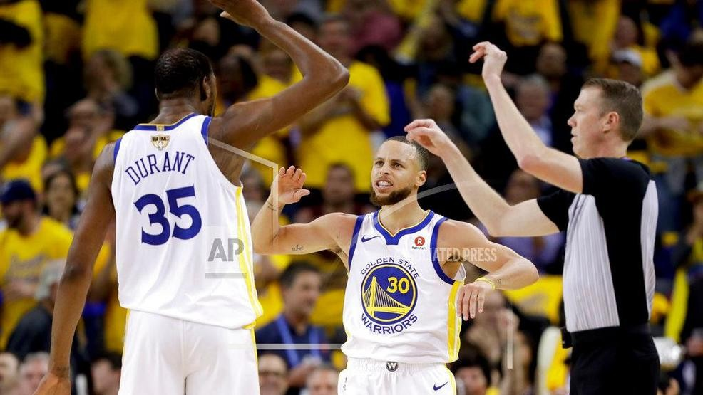 942ba26e4ad Golden State Warriors forward Kevin Durant (35) celebrates with guard Stephen  Curry (30) during the second half of Game 1 of basketball s NBA Finals  against ...